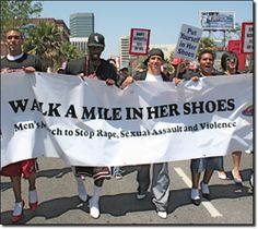 Men marching the streets in high heels to Stop Domestic Violence and Sexual Assault