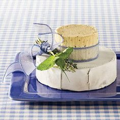 Derby Cheese Hat | No derby celebration is complete without the proper hat; this one is edible. Use rounds of garlic-and-herb spreadable cheese and Brie as a base, and create your own design with ribbon and herbs. Serve with assorted crackers and precut veggies. | SouthernLiving.com