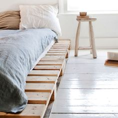 pallets under the bed **paint a pretty color, can repaint every time we change the colors in the bedroom