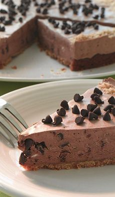 Our Frozen Chocolate Mud Pie uses packaged cookies and frozen whipped topping to make this creamy chocolate pie a cinch to put together. But no one will ever guess. #recipes #desserts #easy