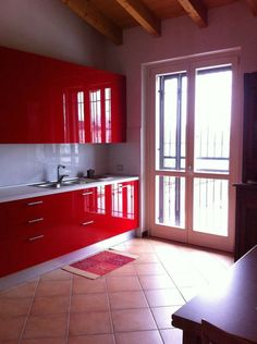 red italian kitchen with glossy cabinets