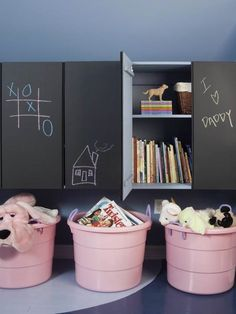 Another good idea for playroom storage: free floating cabinets with room for large toys beneath (ride ons, AG and Barbie pieces)