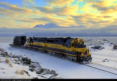 An Alaska Railroad diesel duo haul the last remaining ARR steam locomotive south of Anchorage, Alaska, by Dave Blaze; via Railpictures.net