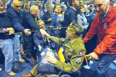 A World War II veteran being thanked for his service after flying on an Honor Flight to see the WWII Memorial in DC.