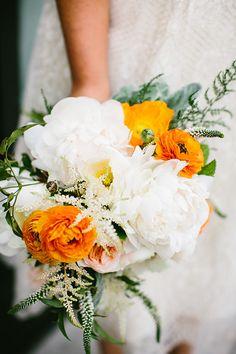 white peony bouquet with a pop of orange, photo by Pen Carlson http://ruffledblog.com/downtown-chicago-wedding #weddingbouquet #flowers
