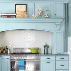 Herringbone Tile Backsplash with subway tile Love the cabinet color and the mantle above the stove