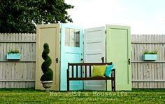 Perfect idea to hide out ugly green utility box - LOVE the hinged door idea - would be great to cover an eyesore in the yard (Ex: a/c unit, pool tools, lawn mower)