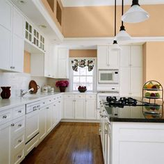 White kitchen cabinets feel airy when paired with this turned-up beige. | Camelhair Coat (B10-2), @dutchboypaint