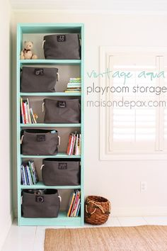 """Fabulous """"vintage aqua"""" bookcase makeover for adorable and functional playroom storage at maisondepax.com #makeover #furniture #paint #diy #tutorial #chalkpaint"""