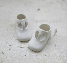 porcelain shoes - cute.  http://www.etsy.com/listing/83496727/porcelain-baby-shoes