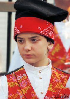 Child with traditional Sardinian costume    #TuscanyAgriturismoGiratola