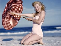 Marylin Monroe's timeless beauty and for inspiring generations of women even since. I want that polka dot umbrella!