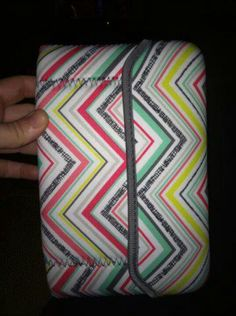 Tote a tablet with kindle fire, in sideways to the top, folded the bottom up to put flap over to secure!