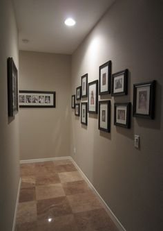 family photo wall collage, picture wall hallway, hallway picture collage, family collage wall, hallway picture frames, galleri, picture frames in hallway, photo collag, photo frame wall collage