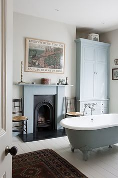 victorain bathroom with claw feet tub in the middle. Beautiful details!