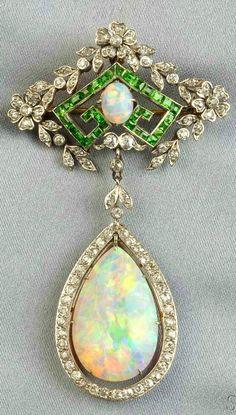 Edwardian Opal, Demantoid Garnet, and Diamond Pendant/Brooch. Via www.bkgjewelry.com/.