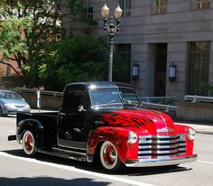 Old black Chevy truck Red Devil Flames White Walls too