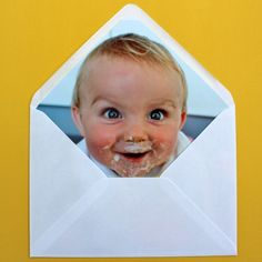 DIY envelope liner with their faces:) So cute for a first birthday party invitation.