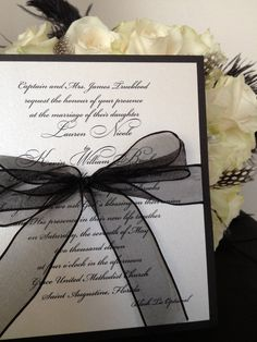 Bow is an elegant touch. Writing too fancy though?  Simple Elegance Black and White Wedding Invitation by LBDesignsbyCO on Etsy