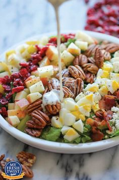 Harvest Cobb Salad - The Perfect Fall Salad with apple, pear, pecans, dried cranberries, bacon, diced eggs, crumbled goat cheese, and a creamy poppyseed dressing. Divine.