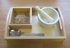 Using a pestle and mortar to grind wheat grains