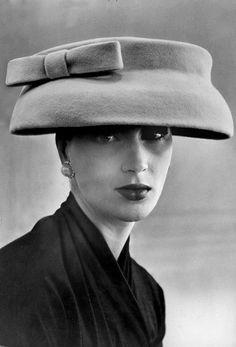 """Hats for fall are hattier, fashion expert declares""(Balenciaga, 1955)"