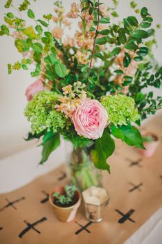 unique table runner idea, photo by Shannon Collins Photography http://ruffledblog.com/maas-building-philadelphia-wedding #weddingideas #inspiration #tablerunner