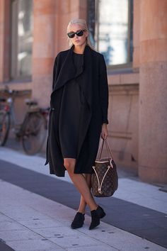 Street Style Spring 2014 - Stockholm Fashion Week Street Style - Harper's BAZAAR LOVE THIS LOOK ALL BLACK, SIMPLE & MATURE LOOKING fashion weeks, black outfits, stockholm sweden, dress, black shoes, street styles, louis vuitton bags, coat, street chic