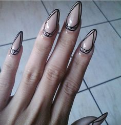 "I have never liked stiletto ""piercing"" nails and could never (nursing school) /would never do this, but the nail art is pretty rad!"