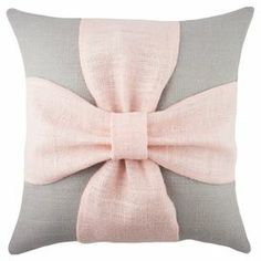 "Handmade burlap pillow with a bow design. Made in the USA.  Product: PillowConstruction Material: Burlap coverColor: Grey and pinkFeatures:  Handmade by TheWatsonShopZipper enclosureMade in the USA Insert included Dimensions: 16"" x 16"""