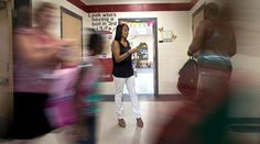 Third grade teacher Tina Hankins Chelgren greets students during the first day of school on Tuesday at  Kiln Creek Elementary in Newport News. (Photo by Joe Fudge / Daily Press)