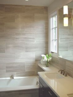 Gray/beige tile with white fixtures and dark vanity