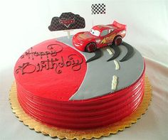 Cars Cake- love the idea of the skid marks and the edging on the cake.