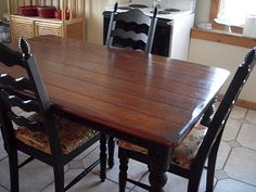 This is my exact kitchen table redone.  I can't stand the way it is currently - this is a fall project for sure - restain top and paint legs base of table black!