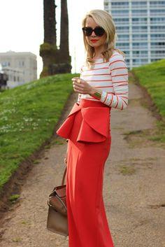 Brilliant pairing of this orange striped shirt and long peplum skirt.