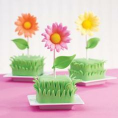 Plant a garden! Outfit 2-in. squares cut from a Sheet Pan cake with fondant daisies created with Daisy and Leaf Cut-Outs and Flower Forming Cups.