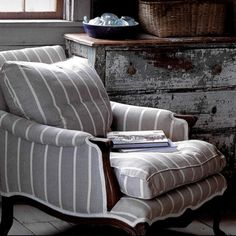 Bergere Chair - i love everything about this picture - the fabric on the chair, the chippy dresser, the basket and the floors
