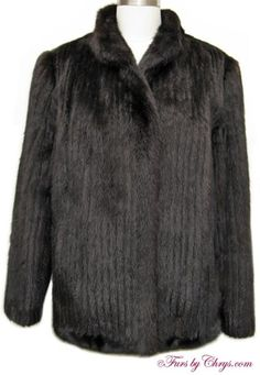 Ranch Mink Jacket #RM724; $800.00; Excellent Condition; Size range: 8 - 12. This is a beautiful genuine corduroy ranch mink fur jacket. It features a small collar with stays and straight sleeves.  The lining is solid black and there is NO MONOGRAM.  This is a very versatile ranch mink jacket which may be dressed up or down and will bring your wardrobe to life!