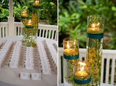 Rent 3 different size cylinders, fill with orchids, water and floating candle. Wrap with accent color ribbon