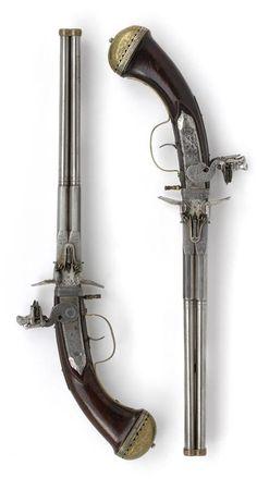 Pair of four-barrelled flintlock turn-over pistols with double locks  by Johan Krach  Maastricht (?)  circa 1665
