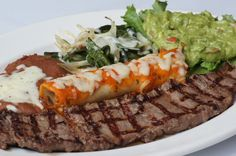Tampiqueno - Grilled opened prime tenderloin steak served with your choice of enchilada (Nortena, red, green, mole either chicken or cheese) grilled Poblano peppers, onions and cheese ~ Authentic Mexican Cuisine in Katy, TX