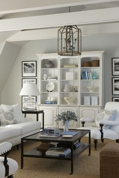 white with warm textures, white bookcase, black and white artwork, lantern