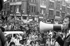 """""""The speaker is standing near the Clifton Rise corner, the buildings opposite are on New Cross Road, including corner of Laurie Grove."""" Transpontine: Lewisham '77 photos by Chris Schwarz"""