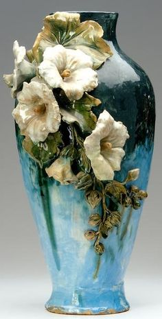 T.J. WHEATLEY Tall Albertine vase modeled with applied hibiscus on a barbotine painted ground, c. 1880