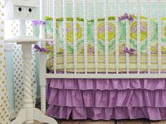We love this pop of purple in a nursery! {Beautiful crib bedding from @Tushies And Tantrums} #nursery #crib #bedding