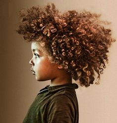 I wonder if I can get my boys hair this long! Love it