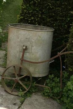 old water bucket and rolling cart