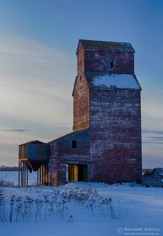 Ghostly Giant ~ This elevator stands in the ghost town of Reynaud, one of many such towns throughout the province. Photo by Branimir Gjetvaj ~ Saskatchewan, Canada