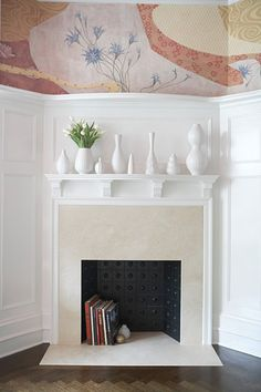 Decorating a non-working fireplace.  Love the decorative  panel inside. Create a surprising bookshelf (© Nick Cardillicchio )