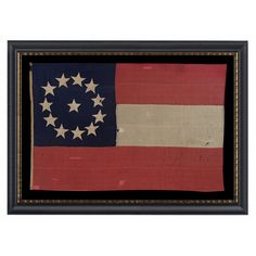 """USA 1861 Confederate 1st National pattern (Stars & Bars) flag, made in the opening year of the Civil War, entirely hand-sewn and with 12 stars arranged in a circular wreath configuration that places one star in the very center. While present on other known Confederate flags, this star count is very unusual. It reflects the eleven states that officially seceded from the Union, plus one of the two key Border States--Missouri--that are typically represented on Southern Cross style Confederate """"B..."""